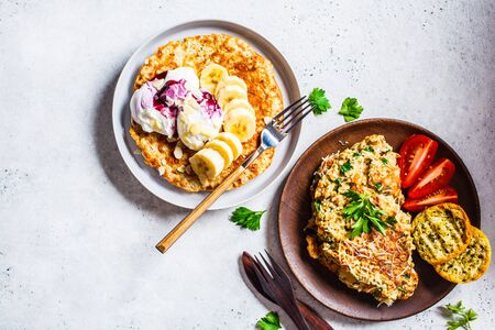 Oatmeal omelette with cheese and sweet oatmeal pancake, copy space. Healthy breakfast concept.