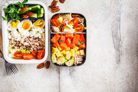 Lunch box with balanced healthy food, top view. Rice with fish, cheese, eggs and vegetables in food containers.