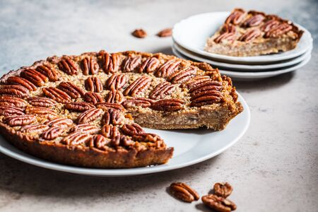 Pecan Pie on gray-brown background. Vegan dessert concept. Stock Photo - 133297963