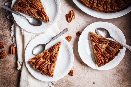 Pecan Pie on gray-brown background. Vegan dessert concept.