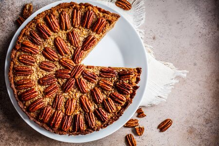 Pecan Pie on gray-brown background. Vegan dessert concept. Stock Photo - 133301720