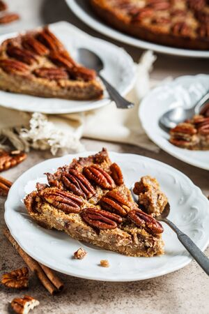 Pecan Pie on gray-brown background. Vegan dessert concept.