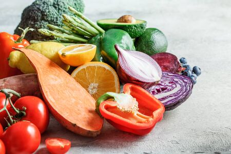 Rainbow colors fresh vegetables and berry background. Detox, vegan food, ingredients for juice and salad.