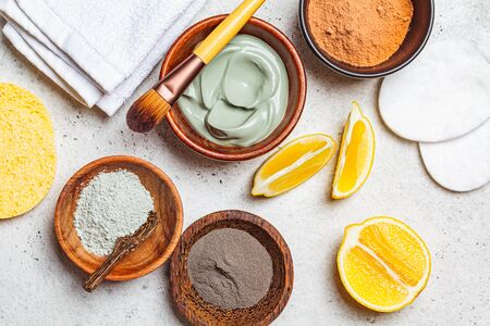 Different types of dry clay in a wooden bowl for the preparation of facial masks. Skincare concept. Zdjęcie Seryjne