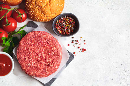 Raw ingredients for burgers, light background, copy space. Cooking background.