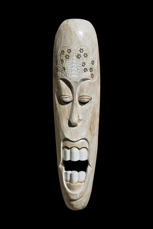 African wooden mask isolated on black background
