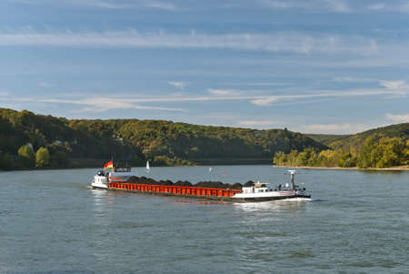 Cargo ship transporting coal  River Rhein, Germany Stock Photo