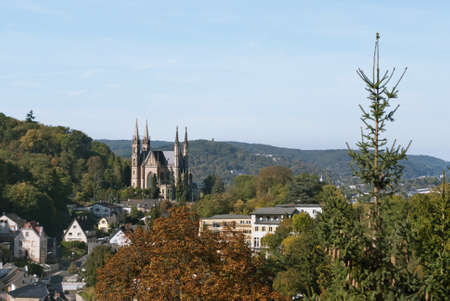 Apollinaris church, on the site of a Roman temple on the Apollinarisberg, a hill above the German town of Remagen  Autumnal landscape Stock Photo - 17420732