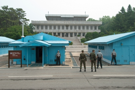 demarcation: PANMUNJOM, SOUTH KOREA - CIRCA JUNE 2012  South Korean Soldiers in DMZ watching border between South and North Korea circa June 2012 in Panmunjom, South Korea  Editorial