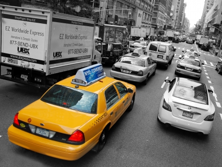 black cab: NEW YORK - CIRCA JULY 2009: The New York City Taxi circa July 2009 in New York City. Taxicabs with their distinctive yellow paint, are a widely recognized icon of the city. Editorial
