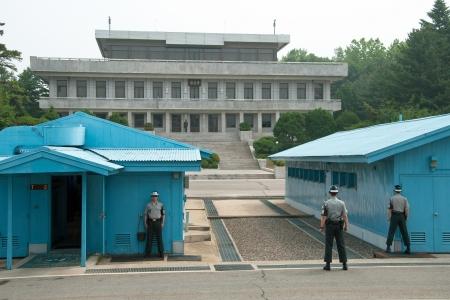 demarcation: PANMUNJOM, SOUTH KOREA - CIRCA JUNE 2012: South Korean Soldiers in DMZ watching border between South and North Korea circa June 2012 in Panmunjom, South Korea.