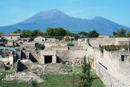 View of the Pompeii ruins in italy with Mount Vesuvius in background