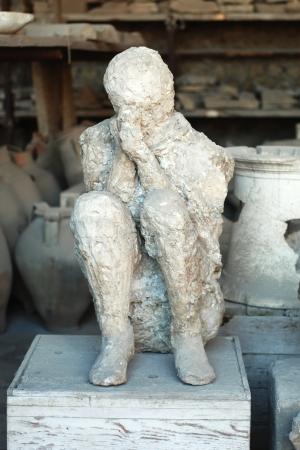Casualty of disaster in Pompeii, dead body covered with dust