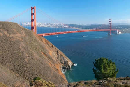 The Golden Gate Bridge in San Francisco during the sunny day with beautiful azure ocean in background Stock Photo - 18386442