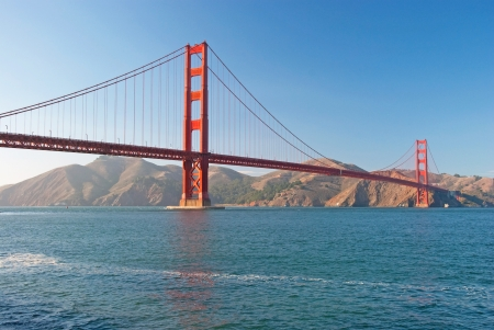 The Golden Gate Bridge in San Francisco during the sunset with beautiful azure ocean in background Stock Photo - 18386419