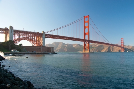 The Golden Gate Bridge in San Francisco during the sunset with beautiful azure ocean in background photo