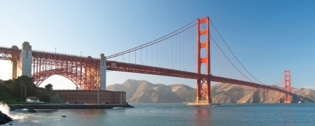 california: The Golden Gate Bridge in San Francisco during the sunset with beautiful azure ocean in background panorama