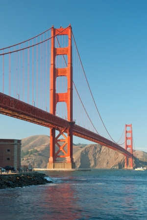 The Golden Gate Bridge in San Francisco during the sunset with beautiful azure ocean in background Stock Photo - 18386427