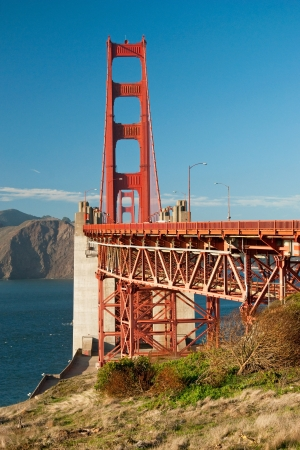 The Golden Gate Bridge in San Francisco during the sunny day with beautiful azure ocean in background Stock Photo - 18386422