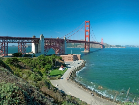 sf: The Golden Gate Bridge in San Francisco during the sunny day with beautiful azure ocean in background Stock Photo