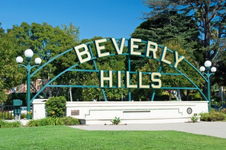 Beverly Hills sign in Los Angeles park with beautiful blue sky in background Stock Photo
