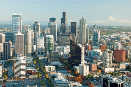 Seattle downtown skyline with view of Mt Rainier in distance photo