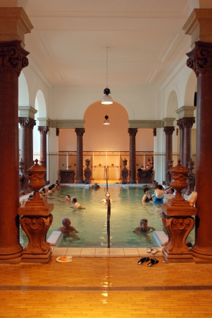 buda: BUDAPEST - CIRCA SEPTEMBER 2009: People have a thermal bath in the Szechenyi spa circa September 2009 in Budapest. Szechenyi Medicinal Bath is the largest medicinal bath in Europe.