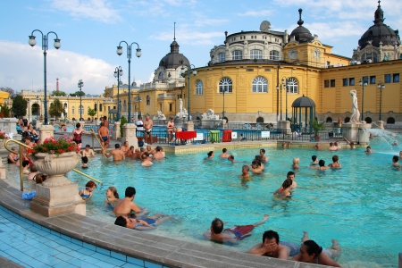 thermal spring: BUDAPEST - CIRCA SEPTEMBER 2009: People have a thermal bath in the Szechenyi spa circa September 2009 in Budapest. Szechenyi Medicinal Bath is the largest medicinal bath in Europe.