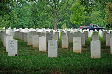 military cemetery: WASHINGTON DC - CIRCA JUNE 2009: Gravestones on Arlington National Cemetery circa June 2009 in Washington DC, USA. Headstones mark soldier graves who died in every conflict from Revolution to Sept 11.