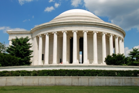 Outdoor view of Jefferson Memorial in Washington DC with beautiful blue sky in background