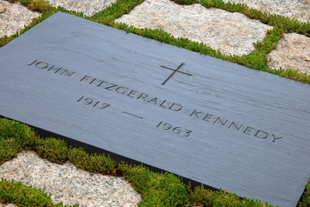 john fitzgerald kennedy: WASHINGTON DC - CIRCA JUNE 2009: Gravestone of JFK on Arlington National Cemetery circa June 2009 in Washington DC, USA. Kennedy was assassinated on November 22, 1963, in Dallas, Texas by Lee Oswald.