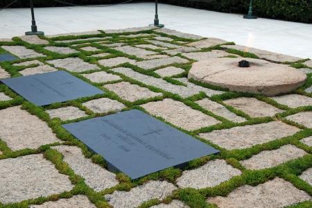 assassinated: WASHINGTON DC - CIRCA JUNE 2009: Gravestone of JFK on Arlington National Cemetery circa June 2009 in Washington DC, USA. Kennedy was assassinated on November 22, 1963, in Dallas, Texas by Lee Oswald.