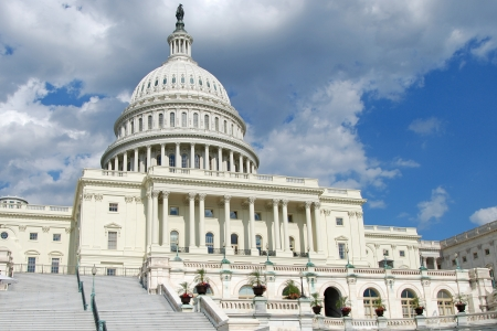 Outdoor view of US Capitol in Washington DC with beautiful blue sky in background photo