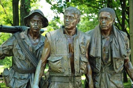 WASH DC - CIRCA JUNE 09: Sculptures of Vietnam War Veterans Memorial circa June 09 in Washington DC, USA. Memorial receives around 3 million visitors each year.   Editorial