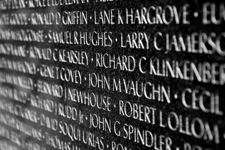 american soldier: WASH DC - CIRCA JUNE 09: Names of Vietnam war casualties on Vietnam War Veterans Memorial circa June 09 in Washington DC, USA. Names in chronological order,from first casualty in 1959 to last in 1975.