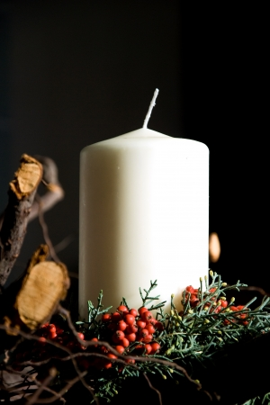 Christmas candle decoration with black background photo