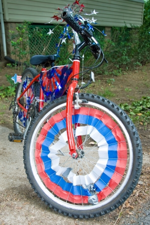 Children bike decorated in american flags prepared for 4th July parade photo