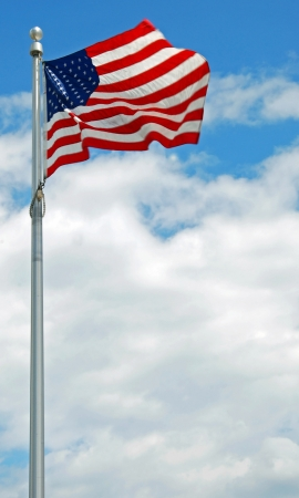 View of the US american striped flag flapping in the wind in Washington DC  photo
