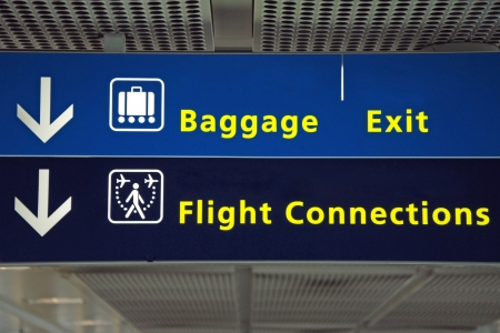 arrival departure board: irport direction flight connection, baggage and exit sign Stock Photo