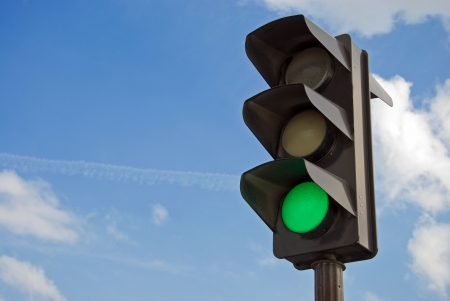 green cross: Green color on the traffic light with a beautiful blue sky in background
