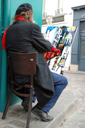 PARIS - CIRCA MAY 2009: Public painter on Montmartre hill in Paris circa May 2009 in Paris, France. Many artists worked around the community of Montmartre such as Pablo Picasso or Vincent van Gogh.