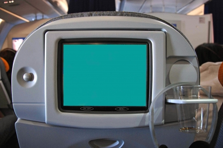 Seat monitor with blank screen in plane photo