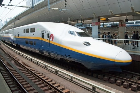 Tokyo, Japan - May 17, 2012: Shinkansen bullet train at Tokyo main railway station in May 2012 Tokyo, Japan.The Shinkansen is the worlds busiest high-speed railway operated by four Japan Railways group companies.