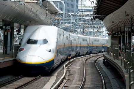 Tokyo, Japan – May 17, 2012: Shinkansen bullet train at Tokyo main railway station in May 2012 Tokyo, Japan.The Shinkansen is the worlds busiest high-speed railway operated by four Japan Railways group companies.