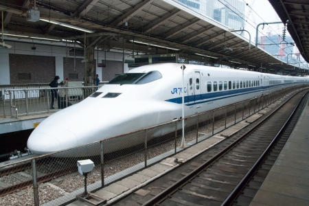 Tokyo, Japan - May 17, 2012: Shinkansen bullet train at Tokyo main railway station in May 17, 2012 Tokyo, Japan.Shinkansen is worlds busiest high-speed railway operated by four Japan Railways group companies.