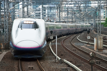 Tokyo, Japan – May 20, 2012: Shinkansen bullet train at Tokyo main railway station in May 2012 Tokyo, Japan.The Shinkansen is the world's busiest high-speed railway operated by four Japan Railways group companies. Stock Photo - 18431835