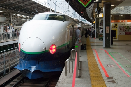 Tokyo, Japan - May 20, 2012: Shinkansen bullet train at Tokyo main railway station in May 20, 2012 Tokyo, Japan.Shinkansen is worlds busiest high-speed railway operated by four Japan Railways group companies.