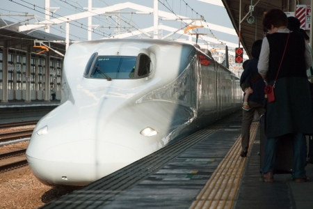 Tokyo, Japan – May 27, 2012: Shinkansen bullet train at Tokyo main railway station in May 2012 Tokyo, Japan.The Shinkansen is the worlds busiest high-speed railway operated by four Japan Railways group companies.