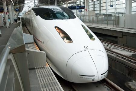 Fukuoka, Japan - June 2, 2012: Shinkansen bullet train at Fukuoka railway station in June 2, 2012 Fukuoka, Japan.Shinkansen is worlds busiest high-speed railway operated by four Japan Railways group companies. Editorial