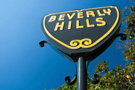 Beverly Hills sign in Los Angeles close-up view with beautiful blue sky in background